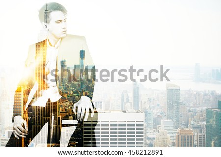 Pensive young businessman on city background with copy space. Double exposure - stock photo