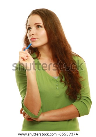 Pensive young college girl with pen looking at copyspace isolated