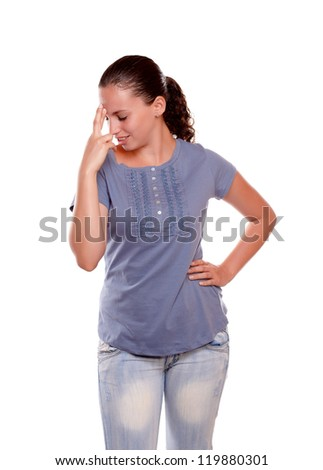 Pensive young female crossing her fingers on blue shirt on isolated background - stock photo