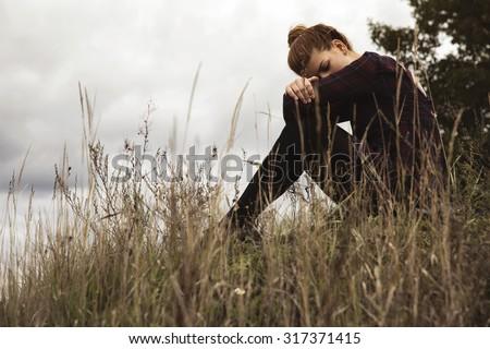 Pensive young girl. - stock photo