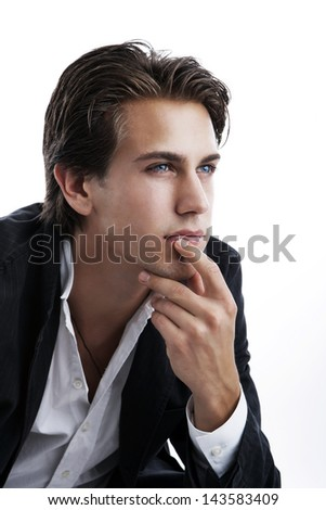 Pensive young man, chin in hand , on white - stock photo