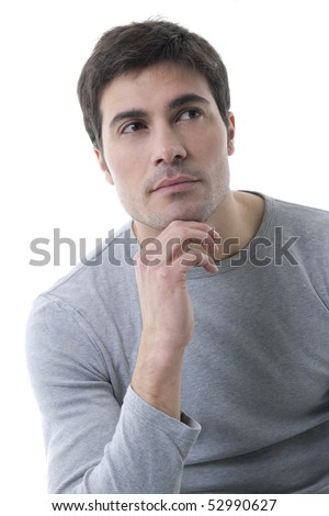 Pensive young man, his hand on chin - stock photo