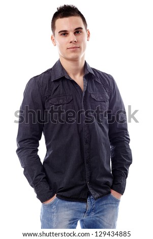 Pensive young man standing with his hands in his pockets, in closeup pose, isolated on white background