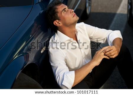 Pensive young man touching his wedding ring his wedding ring - stock photo