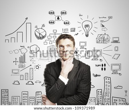 pensive young man with business plan concept - stock photo
