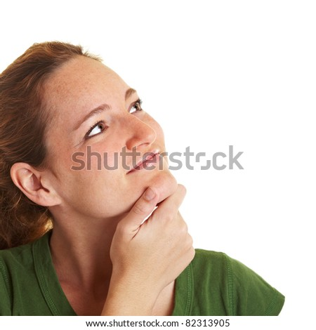 Pensive young woman with hand on her chin looking up - stock photo