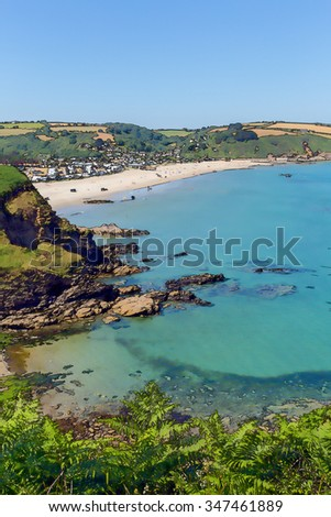 Pentewan beach and coast Cornwall between Mevagissey and Porthpean England UK on a beautiful blue sky summer day bright colours illustration like cartoon effect