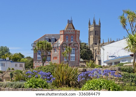 Penzance, Cornwall, England - JULY 31: cityscape in the medieval town Penzance with PZ Gallery and St Mary's Church on July 31, 2015 in Penzance, Cornwall, England - stock photo