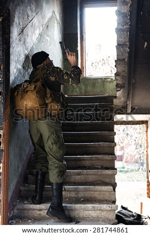Peofessional combatant captured in the ruined house - stock photo