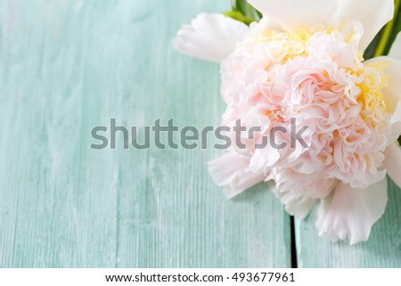 peonies on wooden surface