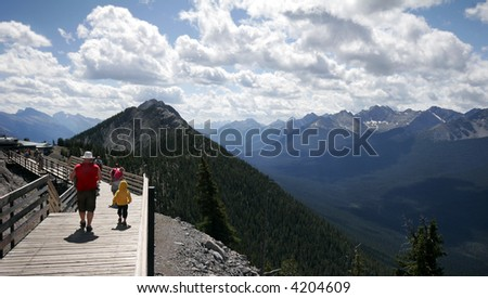 people along the boardwalk at the top of Sulfer Mountain in Banff National Park - stock photo