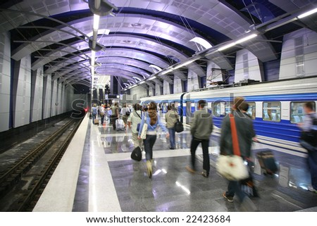 People and a train at metro station - stock photo