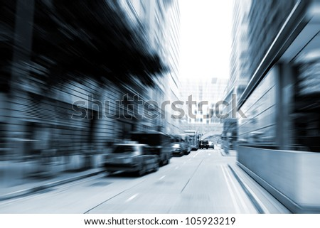 people and car rushing on the street in motion blur