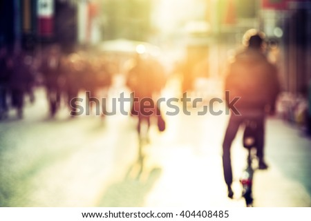People and cyclist in the street, urban, abstract blurry - stock photo
