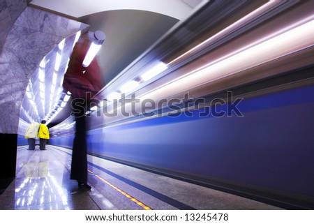 People and fast train subway hall platform - stock photo
