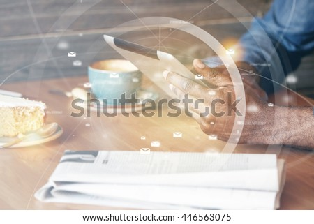 People and technology. Worldwide or global social networking concept. Cropped shot of dark skinned man's hands holding a tablet with new network application, sharing posts and photos using wi-fi - stock photo