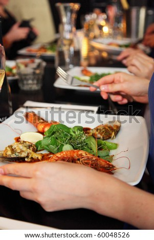 people are eating prawns in a restaurant