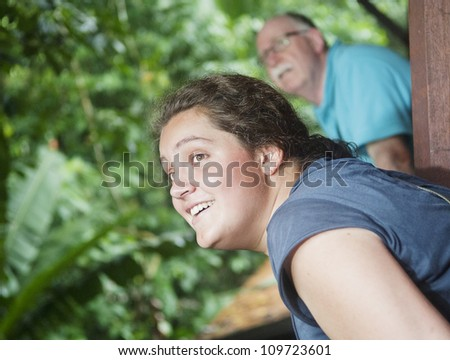 people are looking for birds during a bird watching session - stock photo