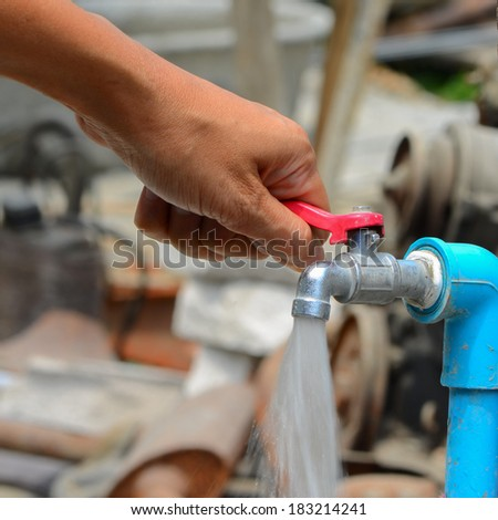 People are opening faucets flowing strongly. - stock photo