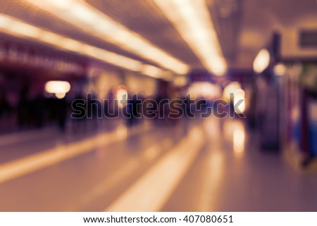 People are shopping in a supermarket. Blur and defocus image as a background and postcard designs. - stock photo