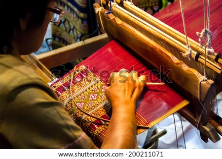 People are silk weaving in Thailand - stock photo