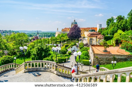 People are walking towards the main entrance of melk abbey in austria - stock photo