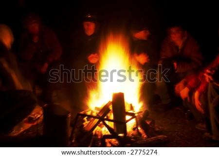 People around campfire - stock photo