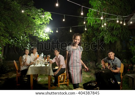 People asians barbecue party In front garden .at night - stock photo