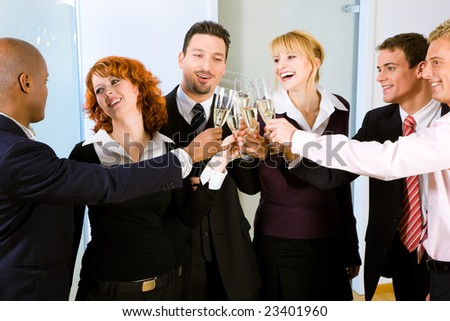 People at a reception at the point where the toast is being given