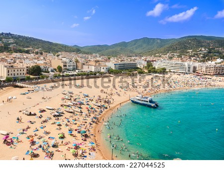 People at beach in Spain - stock photo