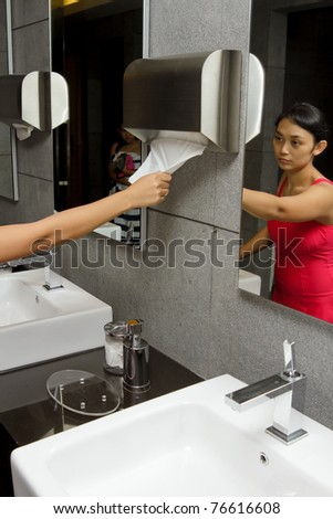 people at clean and hygiene hotel restroom after swimming - stock photo