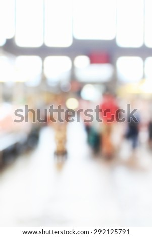People at crowded place inside building, unfocused effect - stock photo