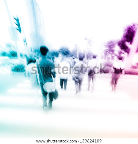 people at pedestrian crossing in big city street abstract blur