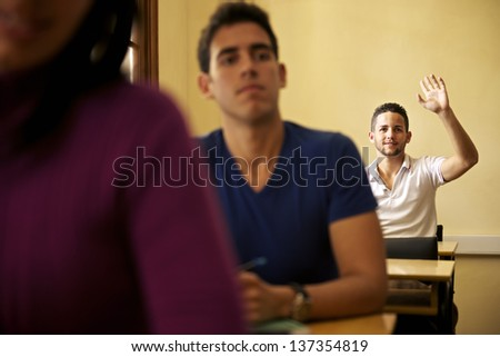 People at school, student raising hand and asking question to professor during class in college, Law School, University of Havana, Cuba - stock photo