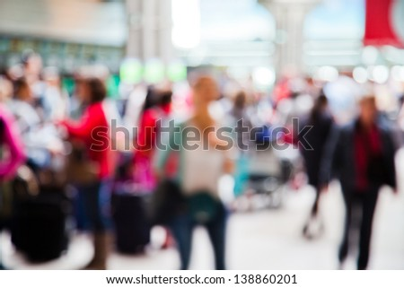 people at the airport in abstract out of focus blur - stock photo