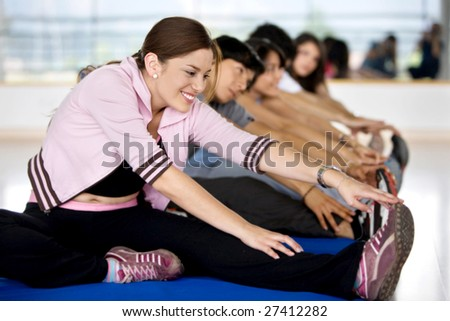 People at the gym during a stretching class - stock photo