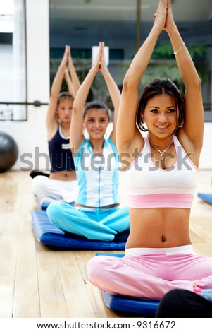 people at the gym taking a class smiling - stock photo