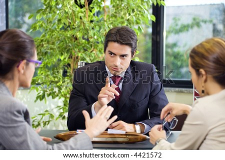 People at work: business team having a meeting