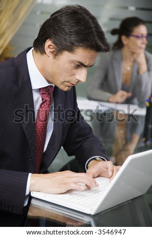 People at work: businessman working with laptop during a meeting