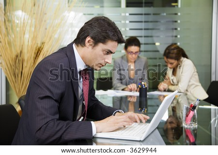 People at work: businessman working with laptop during a meeting - stock photo