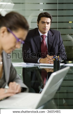People at work: businesswoman working with laptop during a meeting - stock photo
