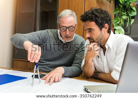 People at work in their office - stock photo