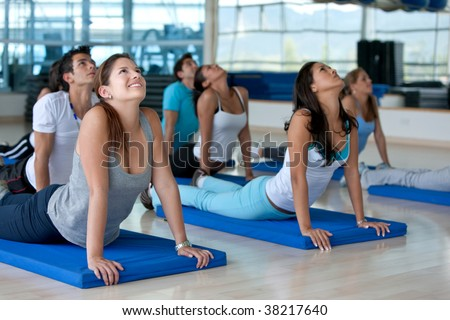 people ath the gym in a stretching class - stock photo