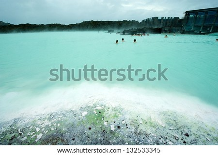 People bathing in the Blue Lagoon geothermal bath resort in Iceland - stock photo