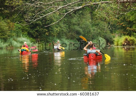 People boating on river, peacefull nature scene - stock photo