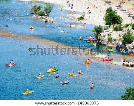 People boating on river, peacefull nature scene, Provence, France - stock photo