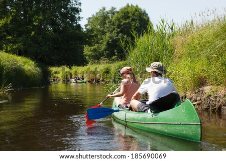 People boating on small river and having fun - stock photo