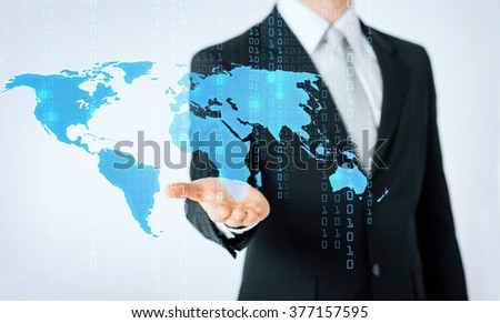 people, business, info technology and cyberspace concept - close up of man hand showing world map and binary code projection - stock photo