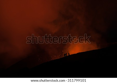 People by a volcano crater - stock photo