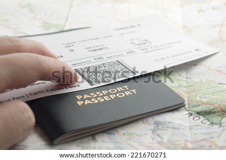 People carrying passport and map ready to travel. - stock photo